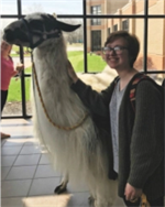 Erika with a llama on campus