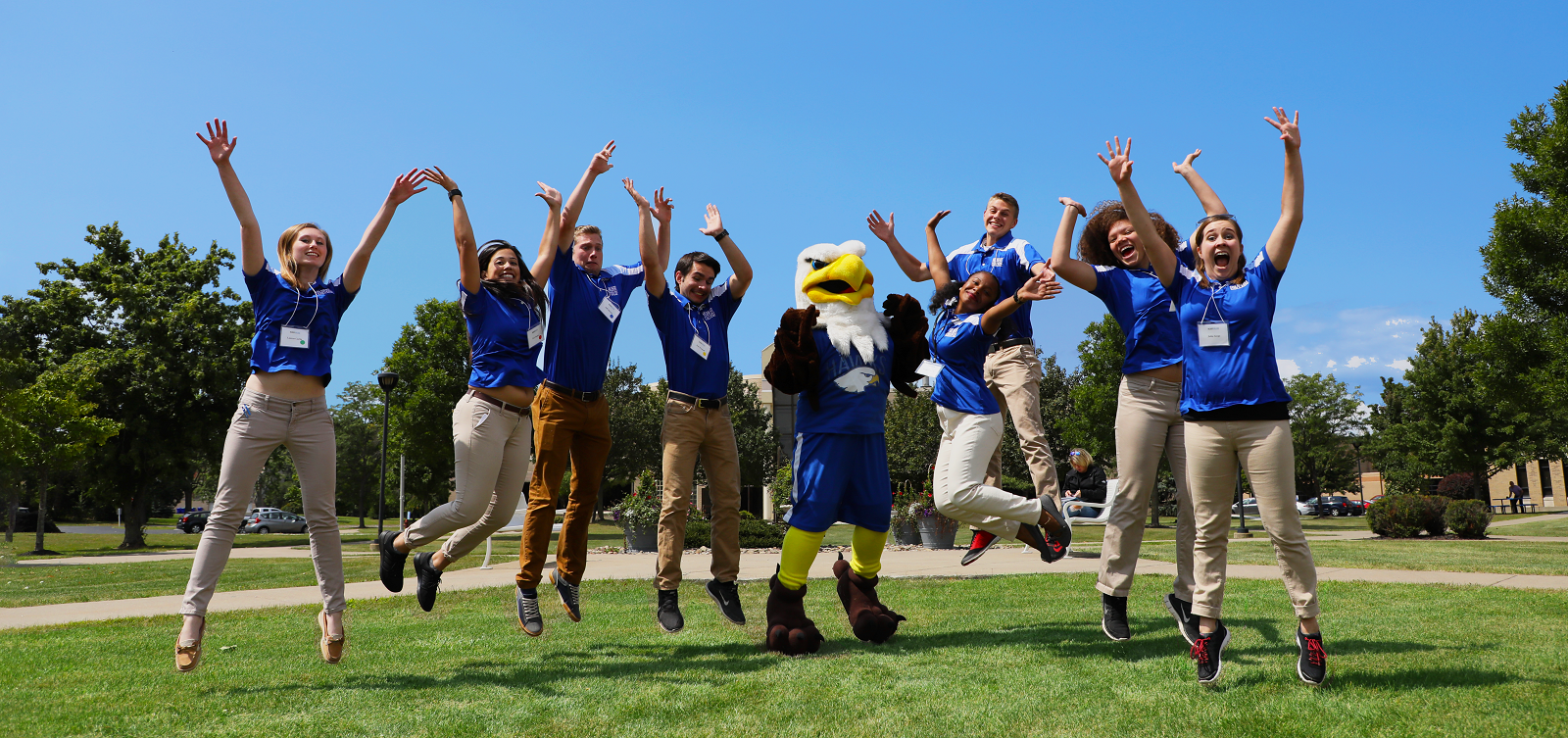 Orientation leaders jumping in the quad
