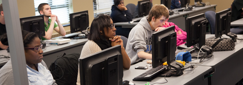 Small Business Management students on computers